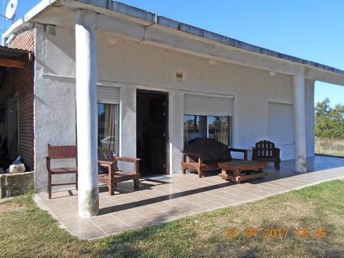 5hás 2450m2 c/ buena casa sobre ruta