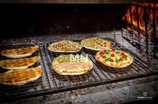 Servicio De Pizzas, Calzones Y Chivitos A La Parrilla