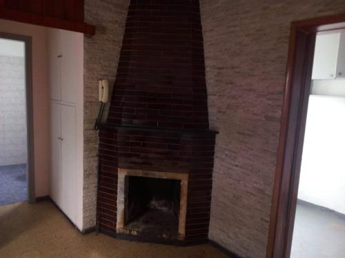 apartamento 1 dormitorio, amplio living con estufa a leña