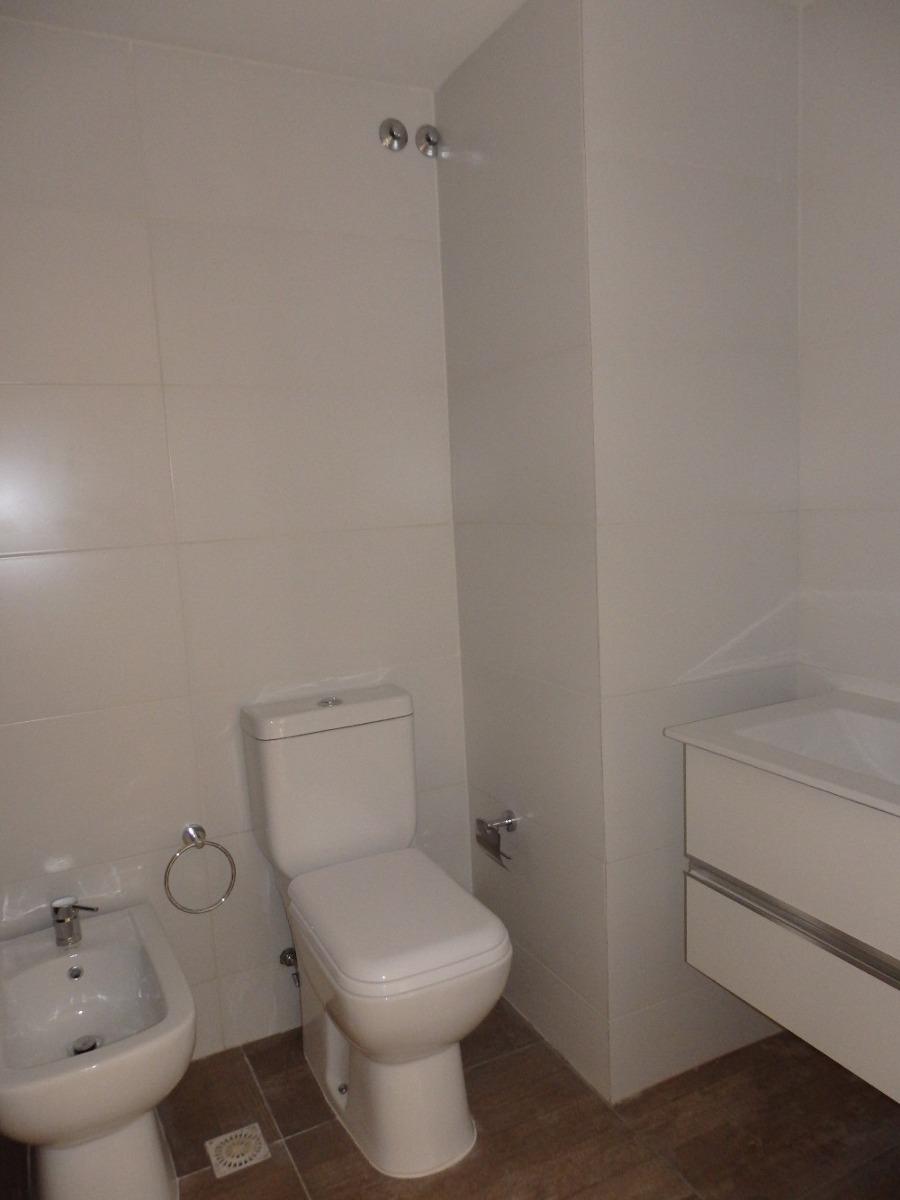 apartamento 1 dormitorio con jardin exclusivo