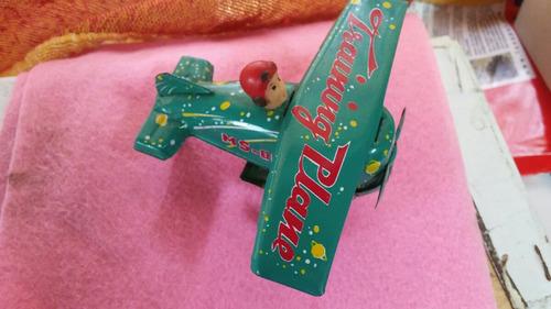 avion de hojalata . antiguedad .litografiado vintage