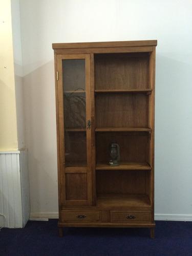 biblioteca de roble con puerta de vidrio y cajones