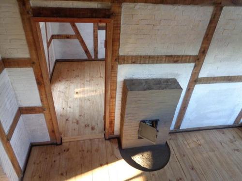bioconstruccion / casa de barro con madera encastrada