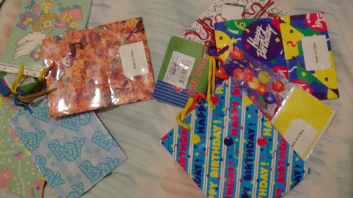 bolsas de regalo diseño infantil, cartulina rígida,kits de 4