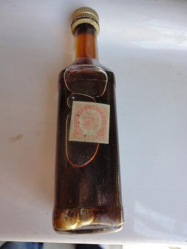 botella antigua de cafe -consulte