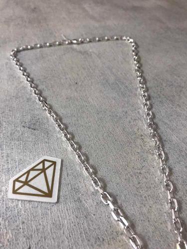 cadena gruesa de 60 cm y 33,5 gr y cruz en plata 925. tuset.