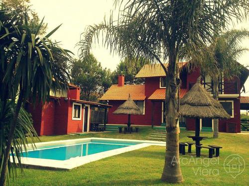 casa con piscina a pasitos del mar en  tio tom, portezuelo, punta ballena
