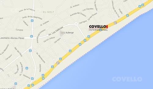casa en primera linea al mar, sobre playa brava, gran terreno para construcción