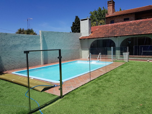 cercos para piscinas en vidrio . modernos y elegantes