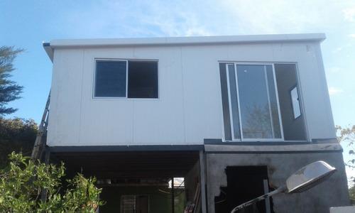 construcción en isopanel, sanitaria, yeso y pintura.