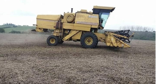 cosechadora new holland con dos plataformas  8040