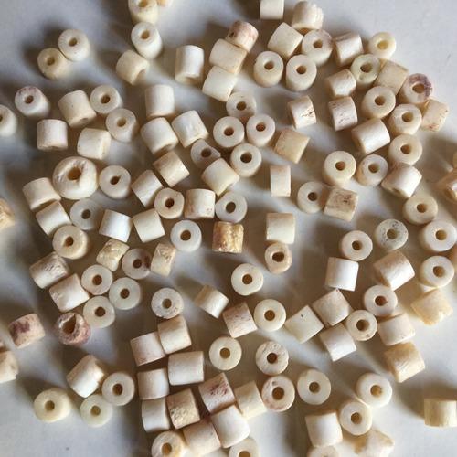 cuentas de hueso de 0,5 cm de largo  por 150 unidades codn5