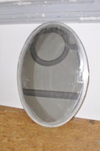 espejo ovalado para reciclar