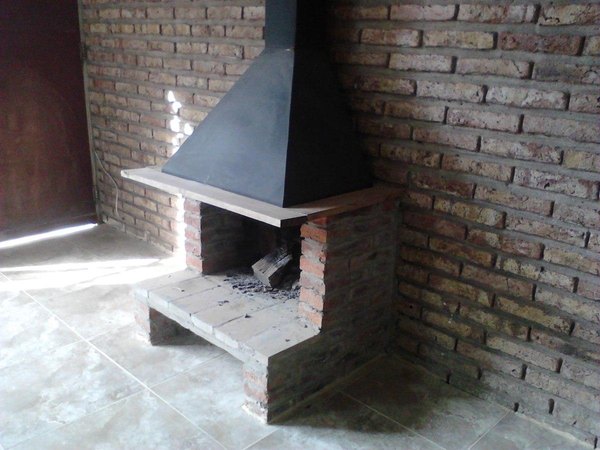 Estufa le a campana metal y ladrillos instalada for Diseno de estufas hogar a lena