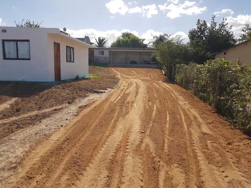 limpieza de terrenos, retroexcavadora, minicargador