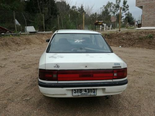 mazda 323 sedan 4 puertas