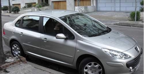 peugeot 307 sedan color gris dorado. unico dueño. año 2010
