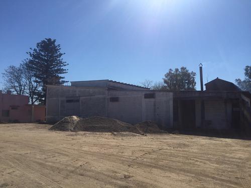 planta industrial en nueva helvecia con casa habitación
