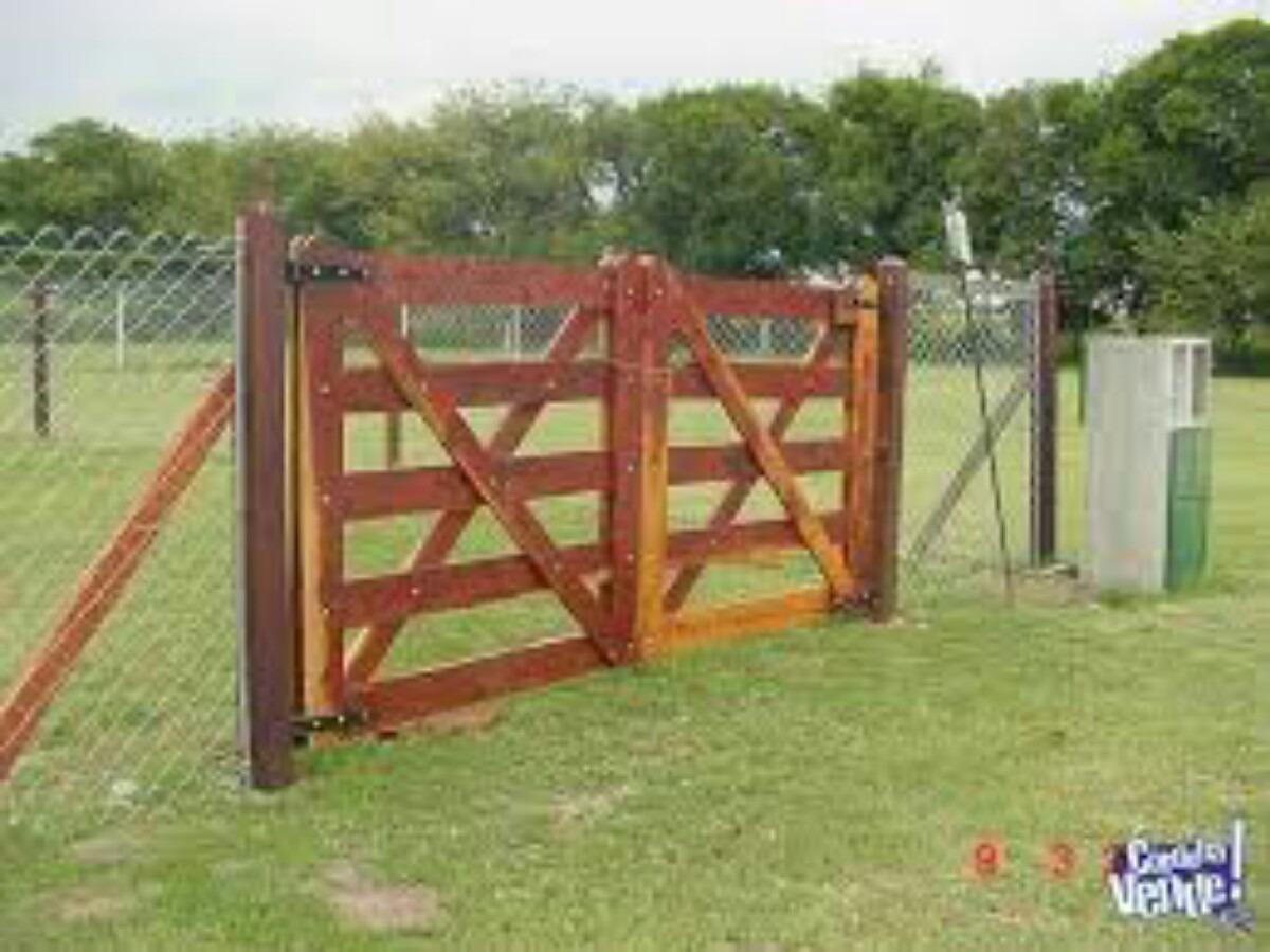 Buena idea adornar la cerca tranqueras y cercos para campo for Puertas de madera para casas de campo