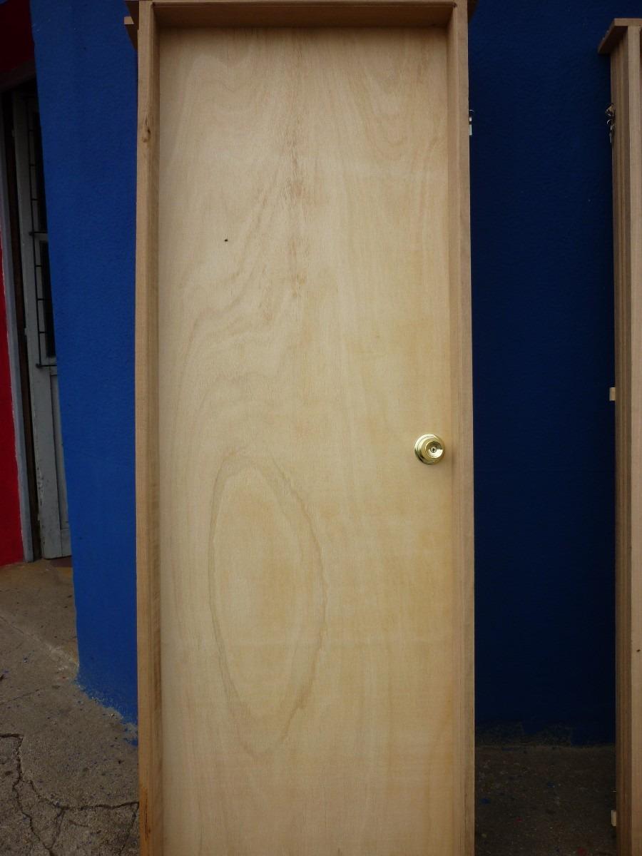Puerta madera interior en madera dura en for Descripcion de puertas de madera