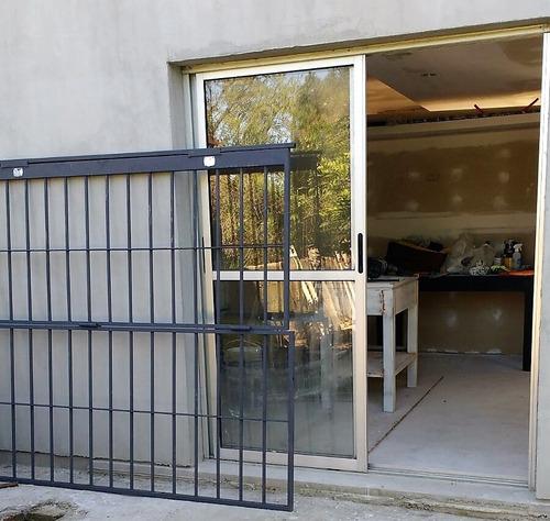 puerta reja 1,5 x 2,0 mts varilla 16 mm 2 cerrojos con mig