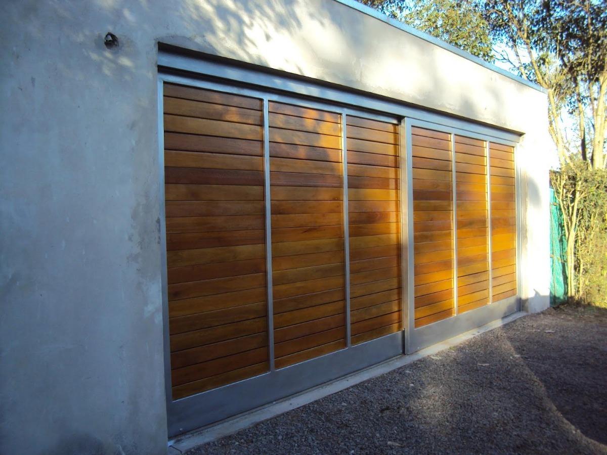 Puertas y portones corredizos o batientes en hierro y for Puertas y portones de madera