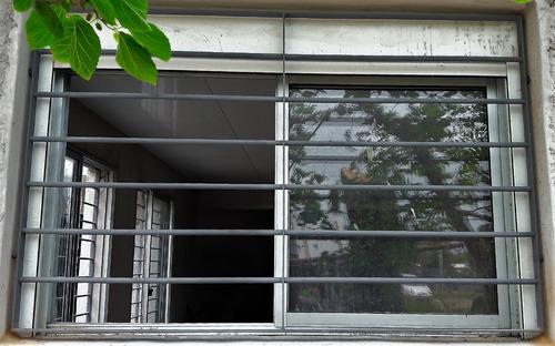 reja para ventana 1,5 x 1,2 mts varillas de 12 mm con garras
