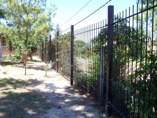 rejas perimetrales, artesania en hierro, aljibe,  hornos