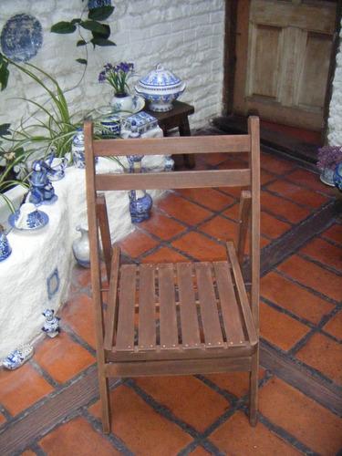 sillas plegables de madera con una mano de protector