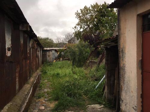 terreno con mejoras esquina av.italia