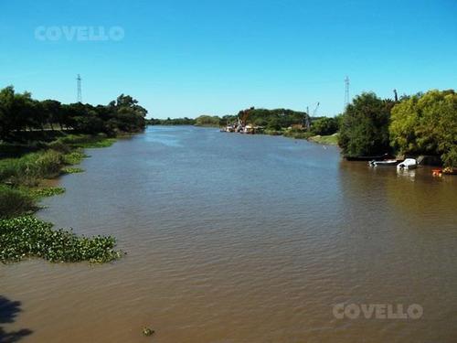 terreno, costa al rio, desarrollo turístico, navegable
