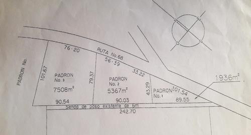 terreno de 1885 m2  con mejoras en progreso, sobre ruta.