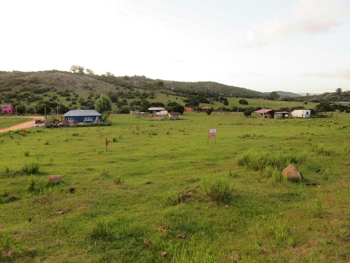 terreno villa serrana, esquina frente a tanque ose.